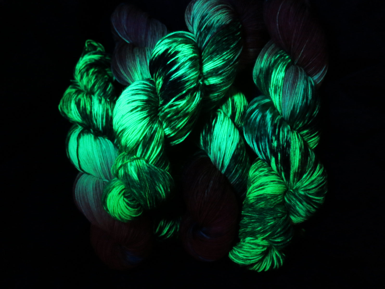 uv reactive hungry caterpillar yarn fluorescing under black light