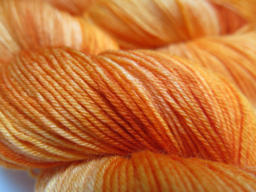 tonal orange merino wool sock yarn for knitting and crochet