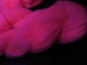 uv reactive pink mohair lace yarn fluorescing under black light