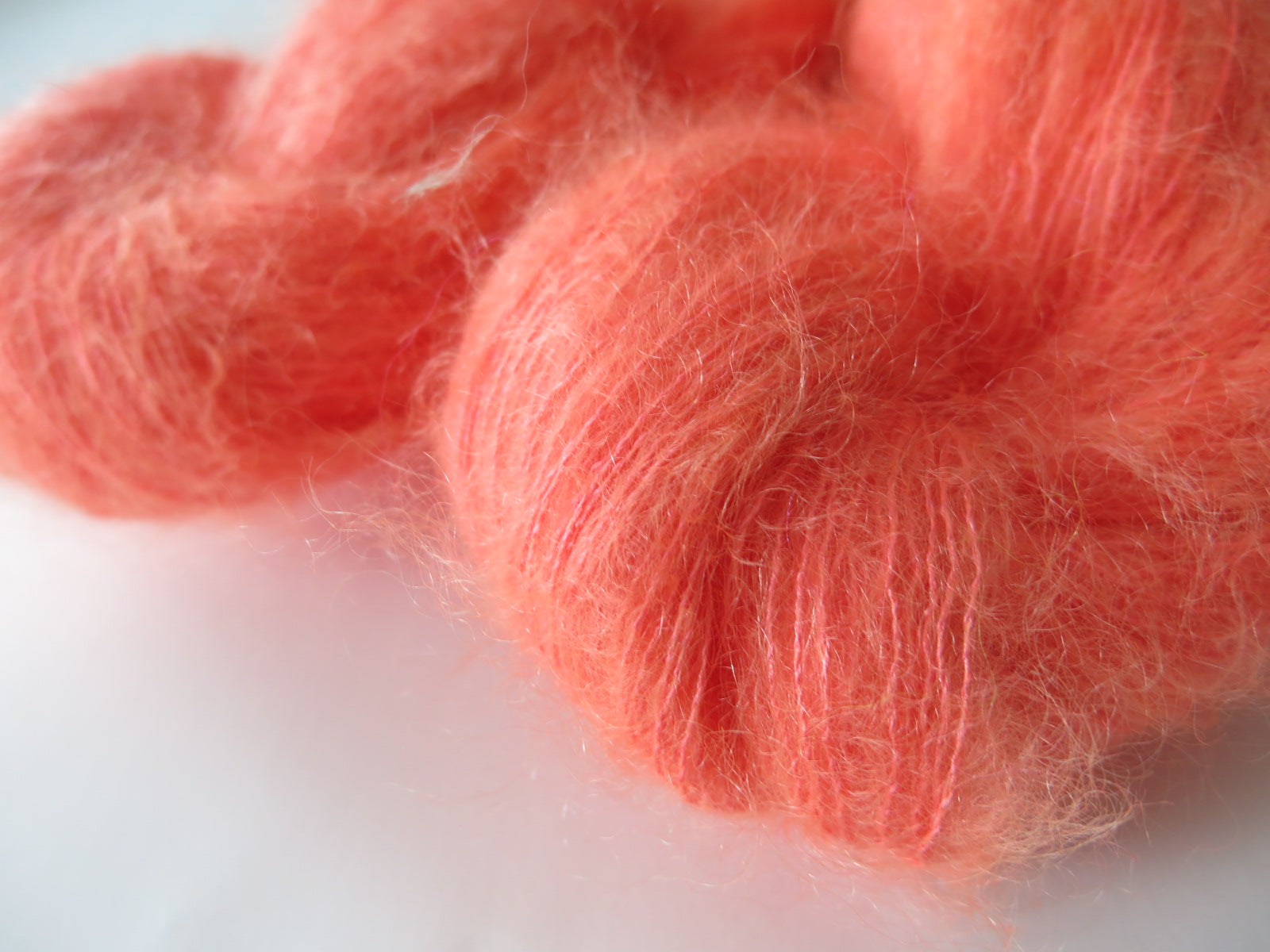 hand dyed uv reactive orange mohair lace weight yarn skeins