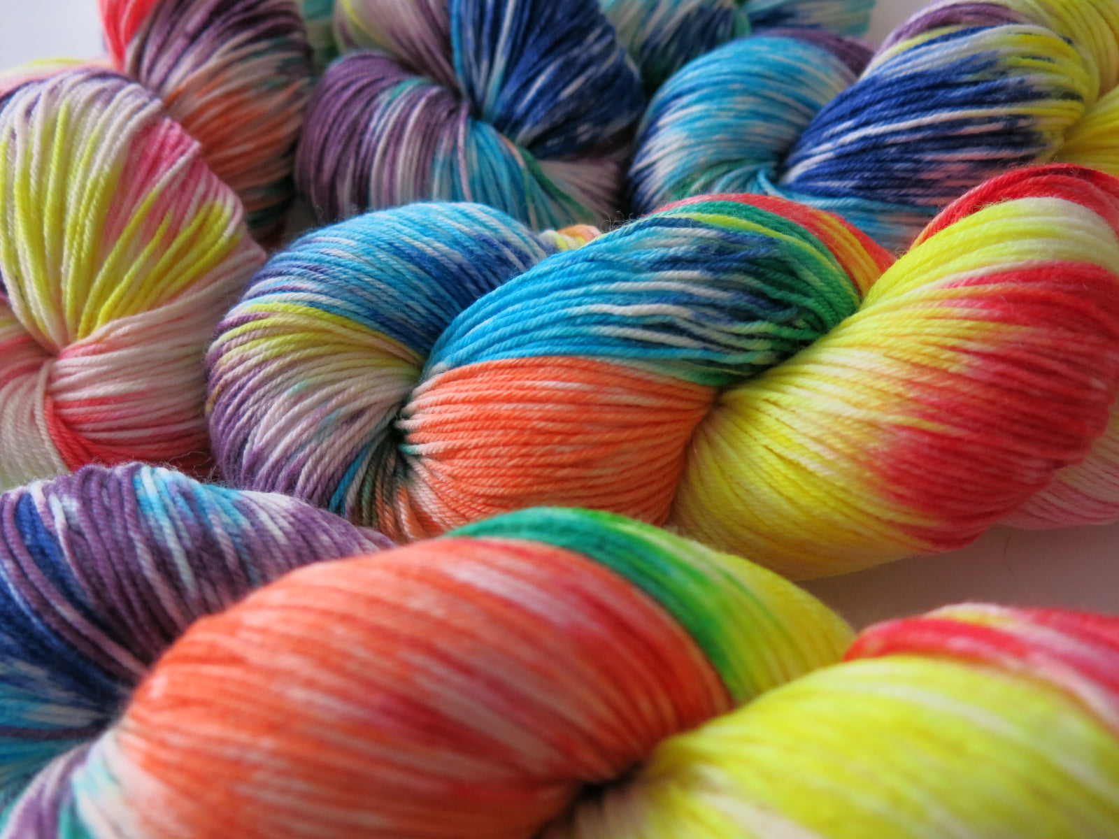 hand dyed rainbow yarn skeins for sock and shawl knitting