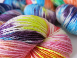 soft rainbow superwash merino sock yarn skeins for knitting