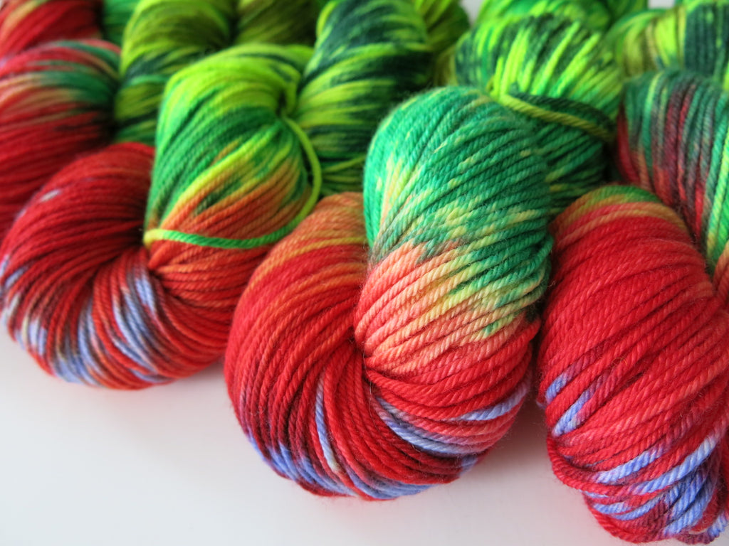 hand dyed red and green yarn inspired by the hungry caterpillar
