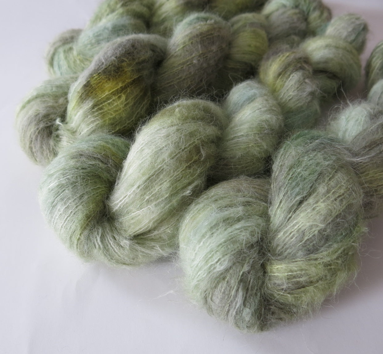 green glass indie dyed lace weight alpaca and silk yarn for knitting weaving and crochet