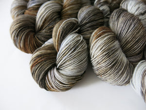 kettle dyed brown and gray superwash merino sock yarn skeins