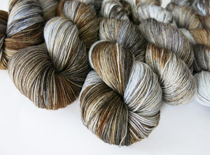 hand dyed selkie coat grey and brown merino sock yarn