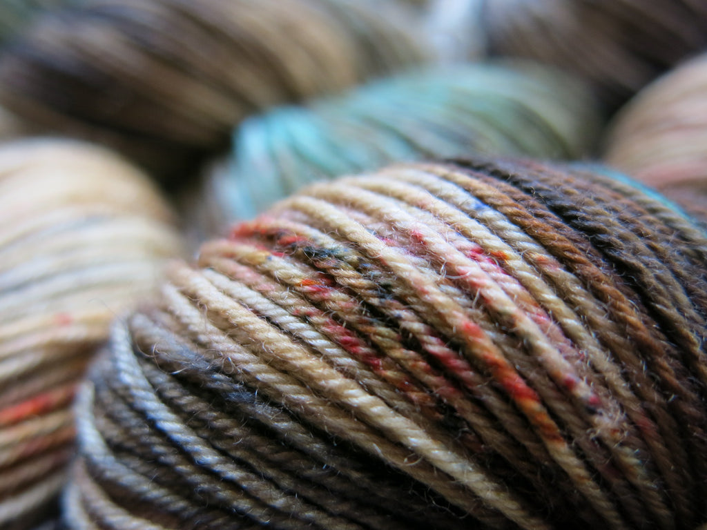 hand dyed brown and blue merino sock yarn for knitting and crochet
