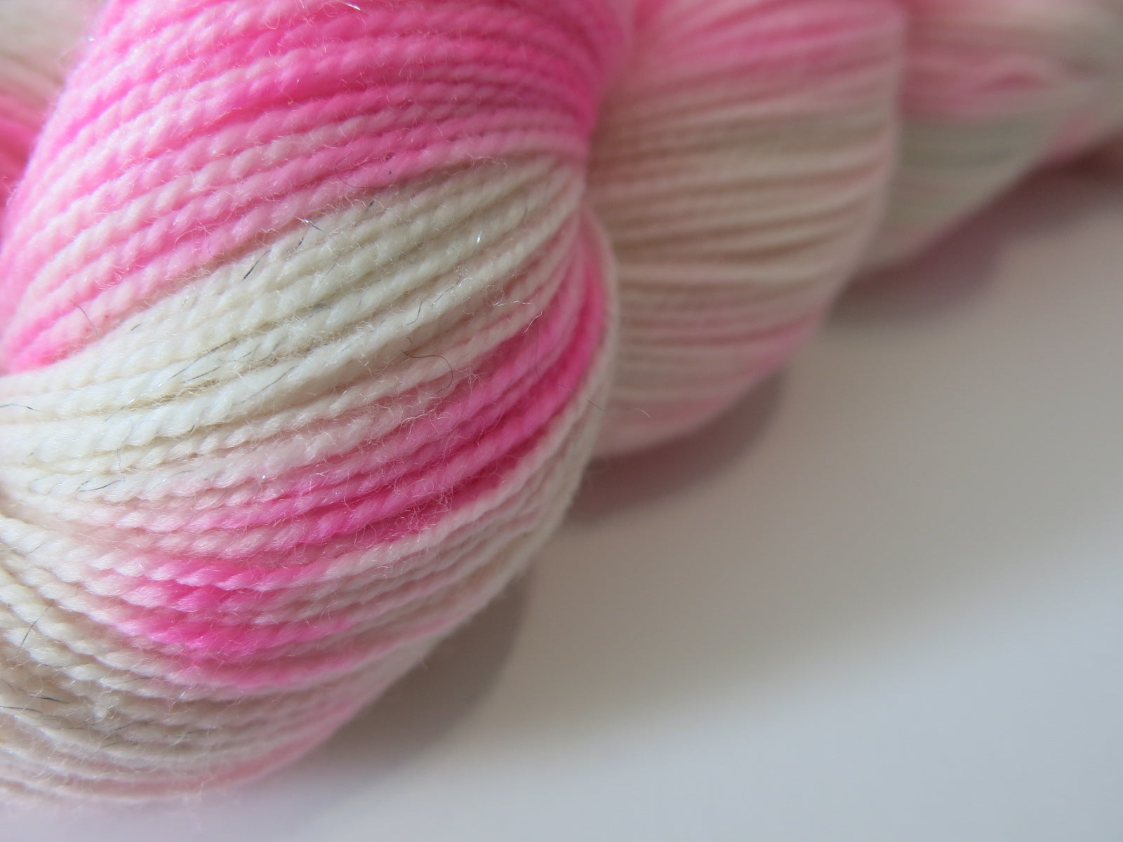 neon pink and white merino sock yarn for weaving and knitting