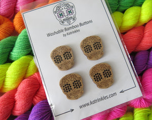 1 inch wooden sugar skull buttons by katrinkles on uv reactive neon yarn