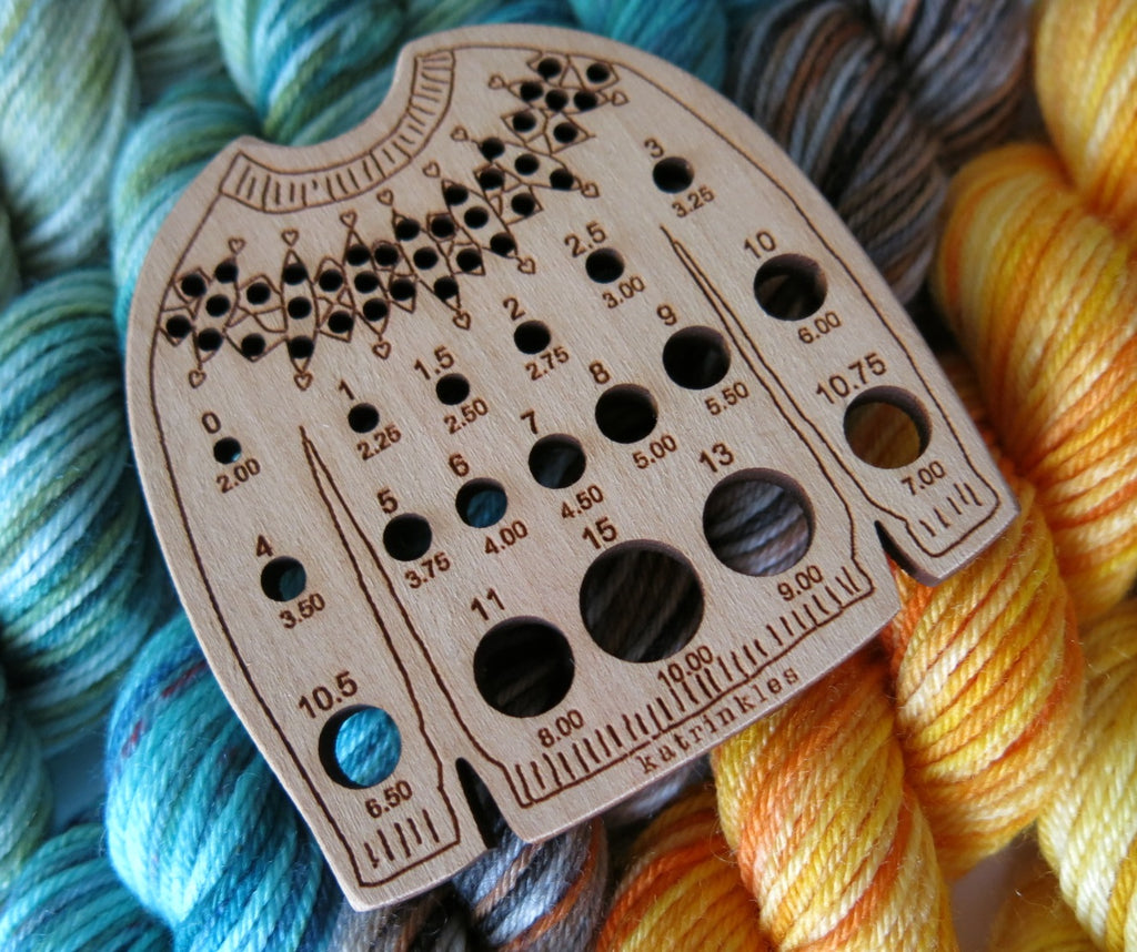 wooden sweater shaped knitting needle gauge with a stitchable yoke