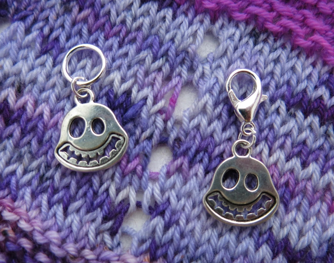 silver coloured smiling ghost face charms on lobster clasps for knitting and crochet