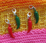 red and green chile charms on lobster clasps for knitting and crochet