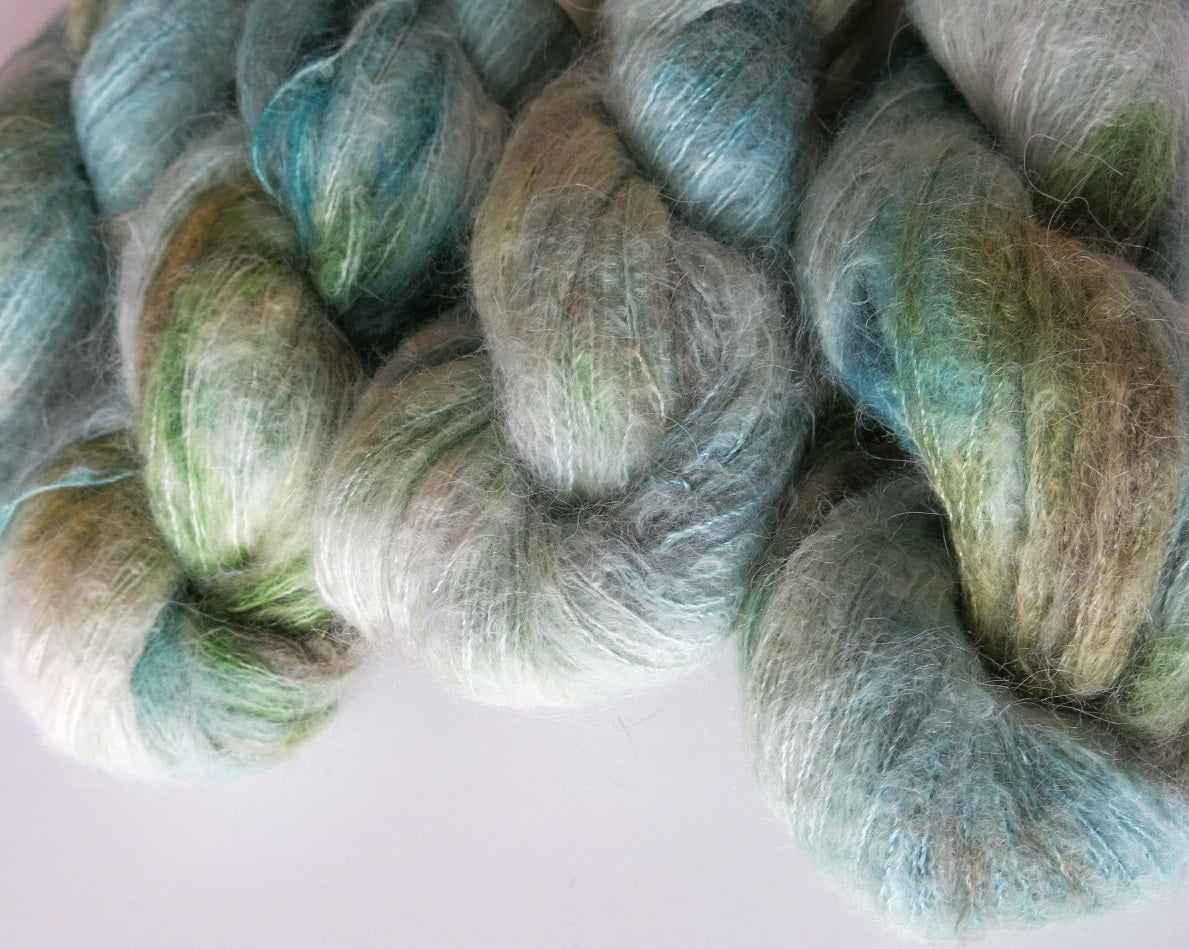 pale blue and green suri alpaca and silk lace weight yarn skeins