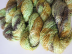 green and brown suri alpaca and silk lace weight yarn skeins