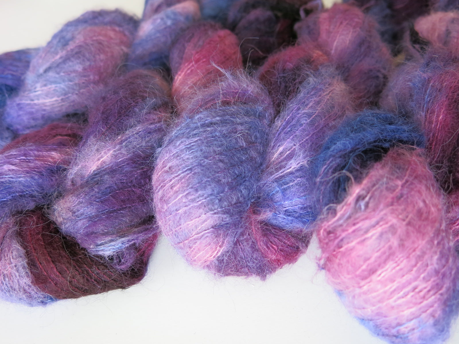 purples and blue suri alpaca and silk lace weight yarn skeins