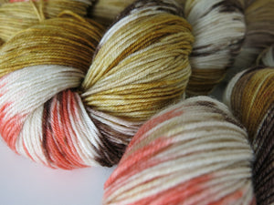 indie dyed brown, orange and tan sock yarn inspired by spiders