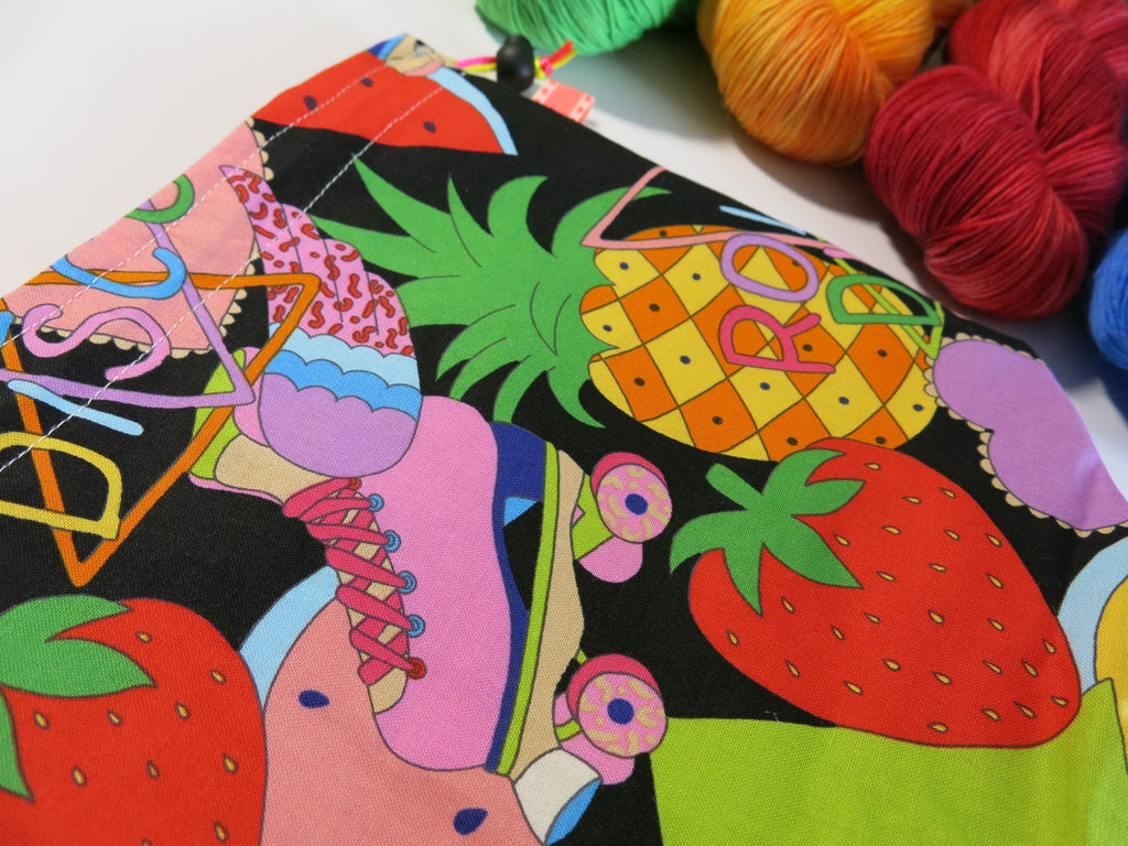 colourful cotton knitting project bag with rollerskates and pineapples