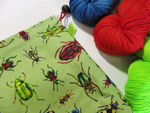 green cotton knitting project bag with colourful beetles and insects