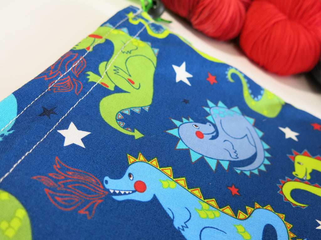 blue cotton knitting project bag with green and blue cartoon dragons