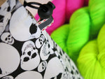 knitting project bag with glowing skulls and neon yarn