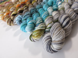 indie dyed mini skein set in greys, blues and speckled browns