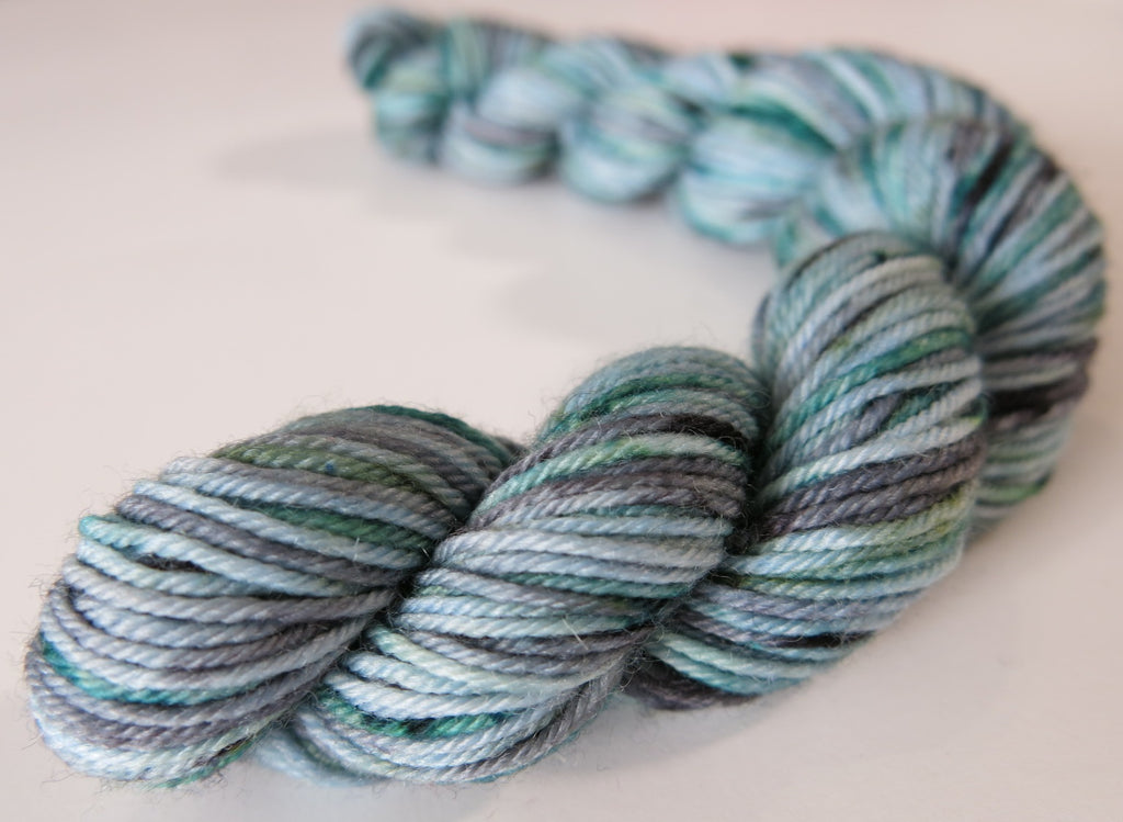 blue green and grey speckled sock yarn mni skein for knitting and crochet