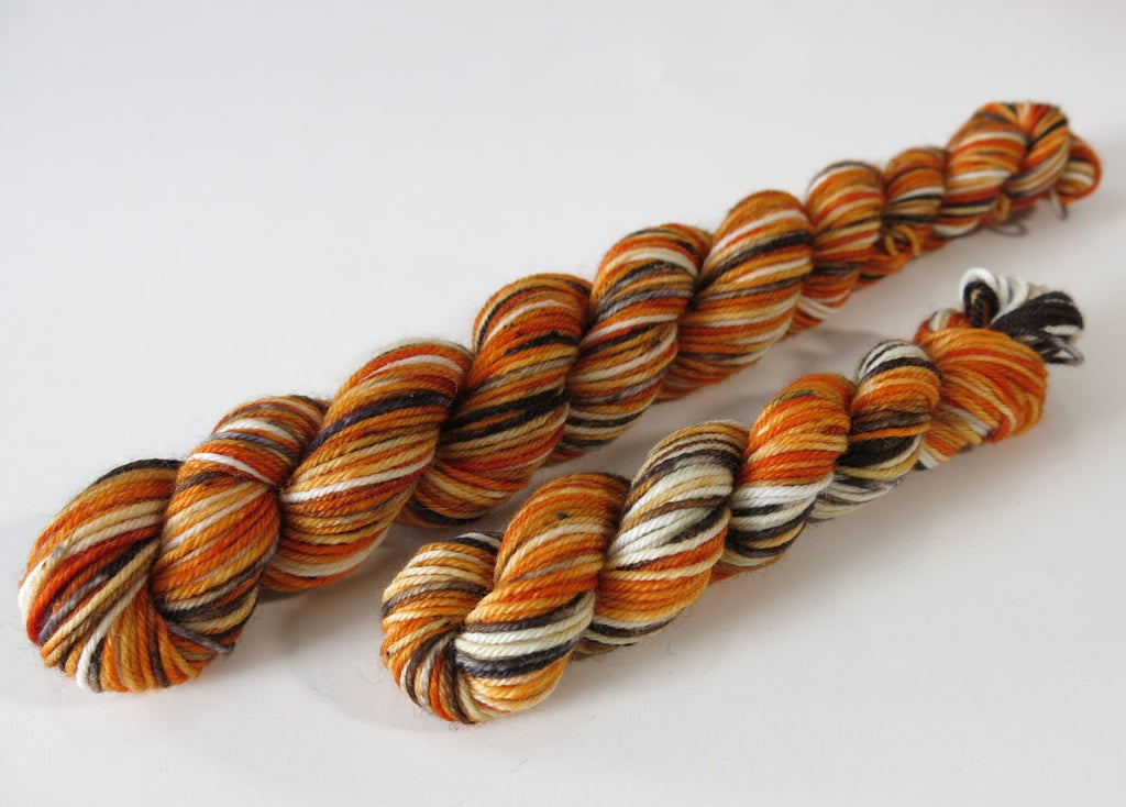 hand dyed merino yarn mini skeins in fox colours of russet orange black and white