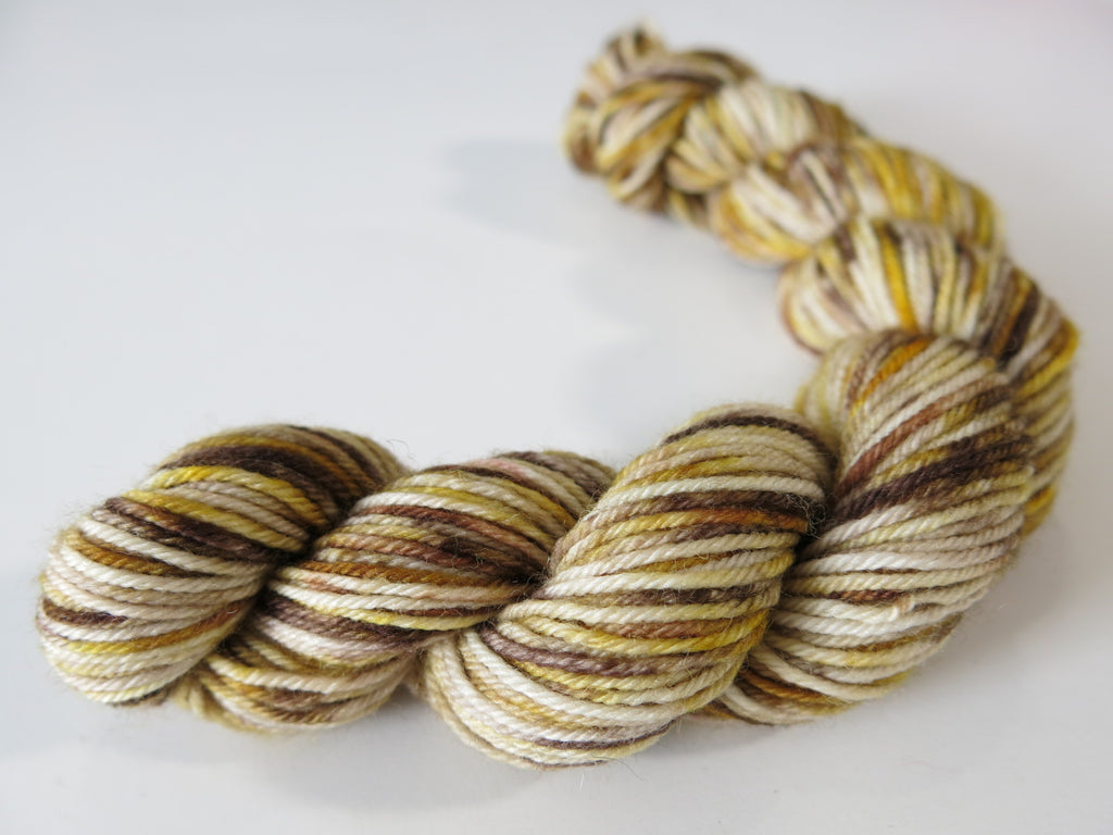 hand dyed speckled brown and golden yellow sock yarn mini skeins