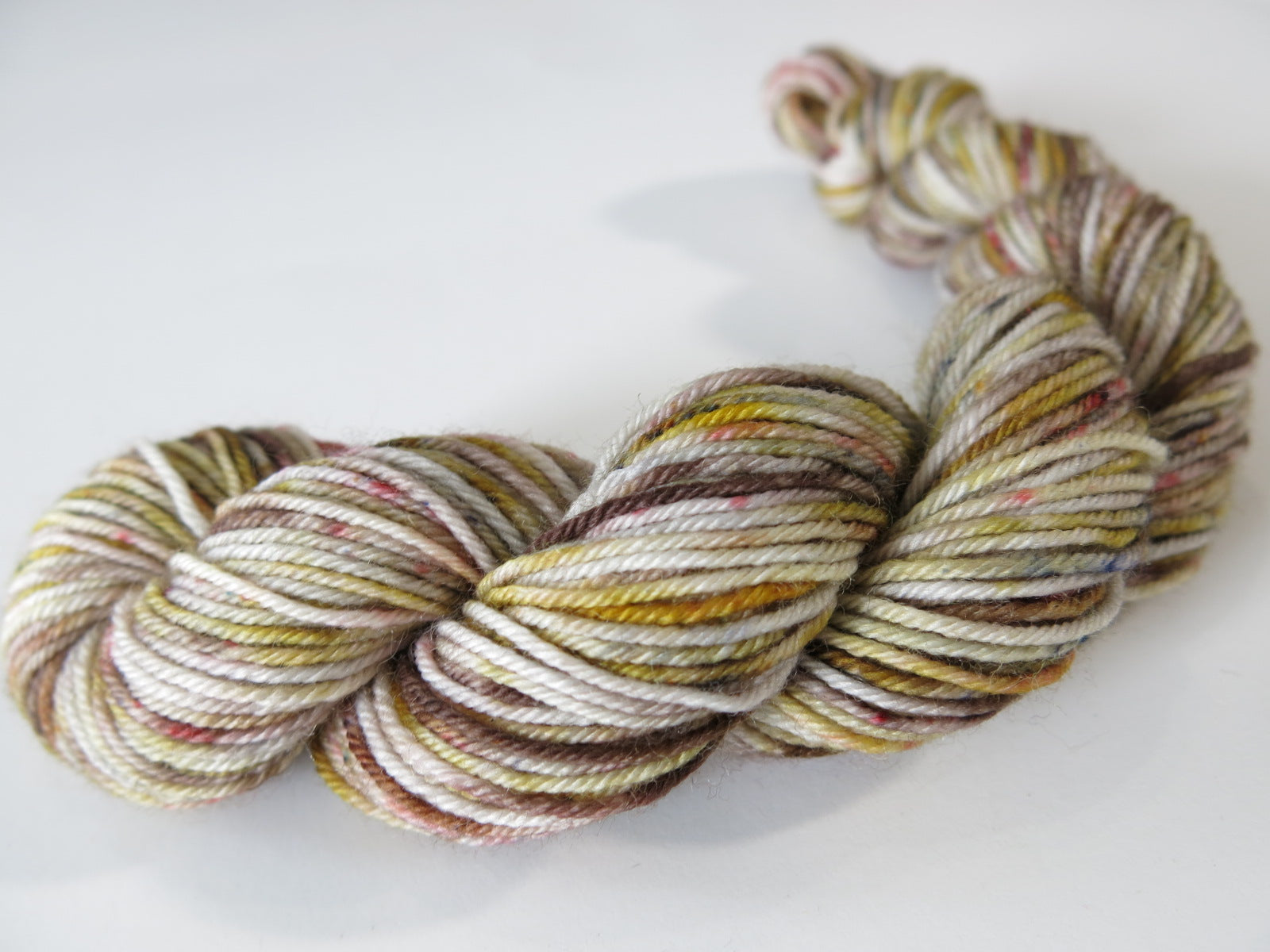 grey brown sock yarn mini skein with red and black speckles