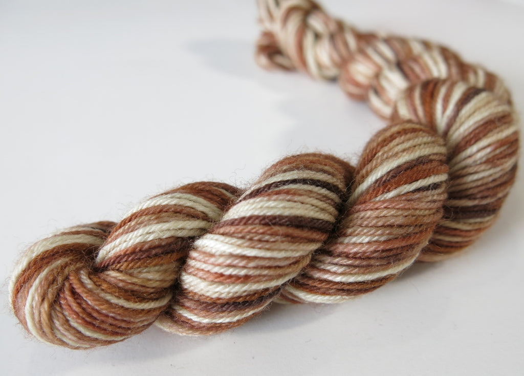 wren bird inspired brown and cream merino yarn skeins