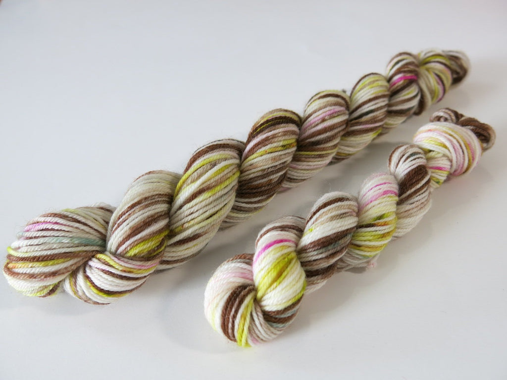 brown and white mini skein with hints of pink and mossy green