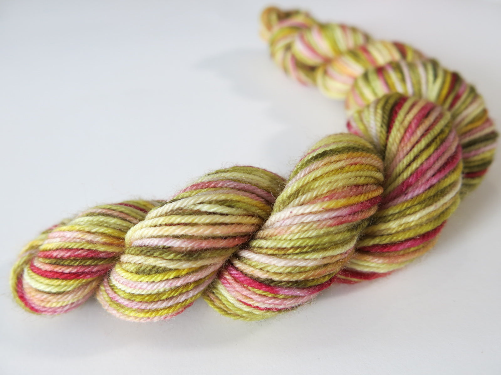 trout inspired hand dyed yarn in greens and reds