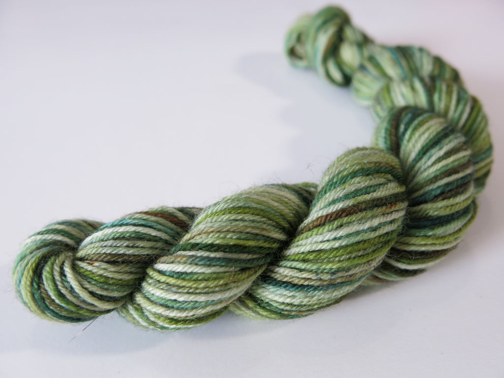 vareigated forest green and brown sock yarn mini skeins