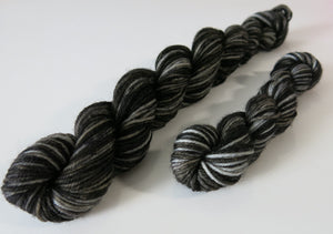 black merino sock yarn skeins with hints of dark grey