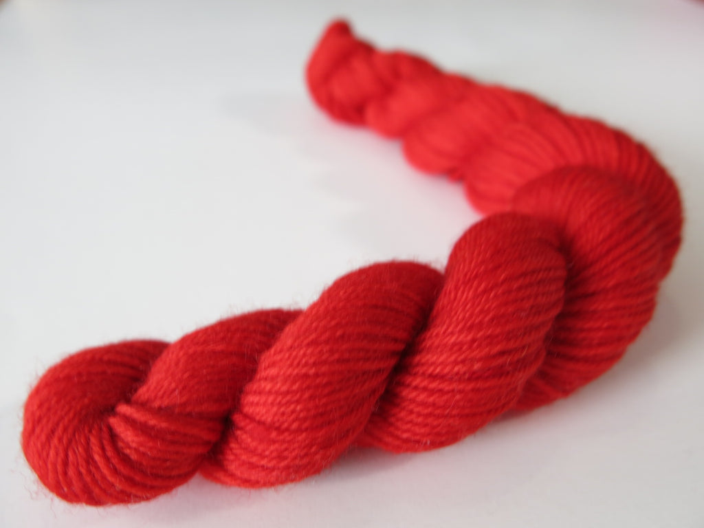 bright solid red sock yarn mini skein for knitting and crochet