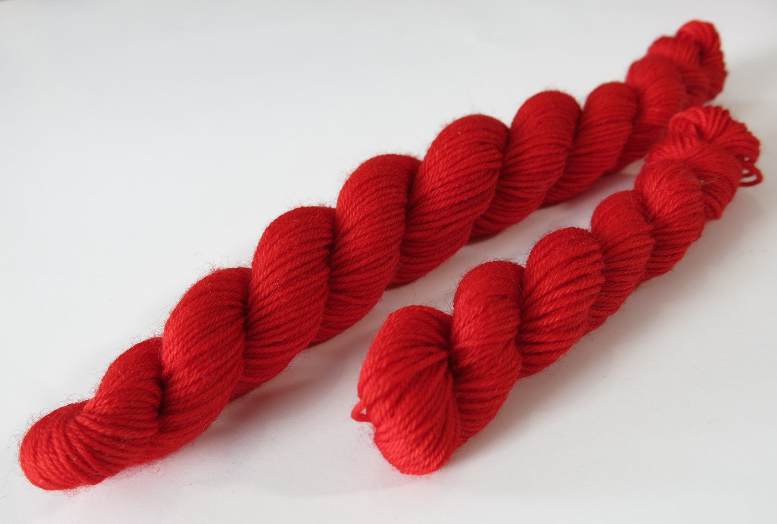 bright solid fairytale red sock yarn mini skein for knitting and crochet