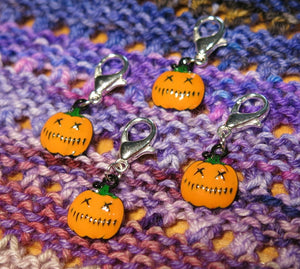 orange enamel jack o lantern halloween stitch markers on lobster clasps