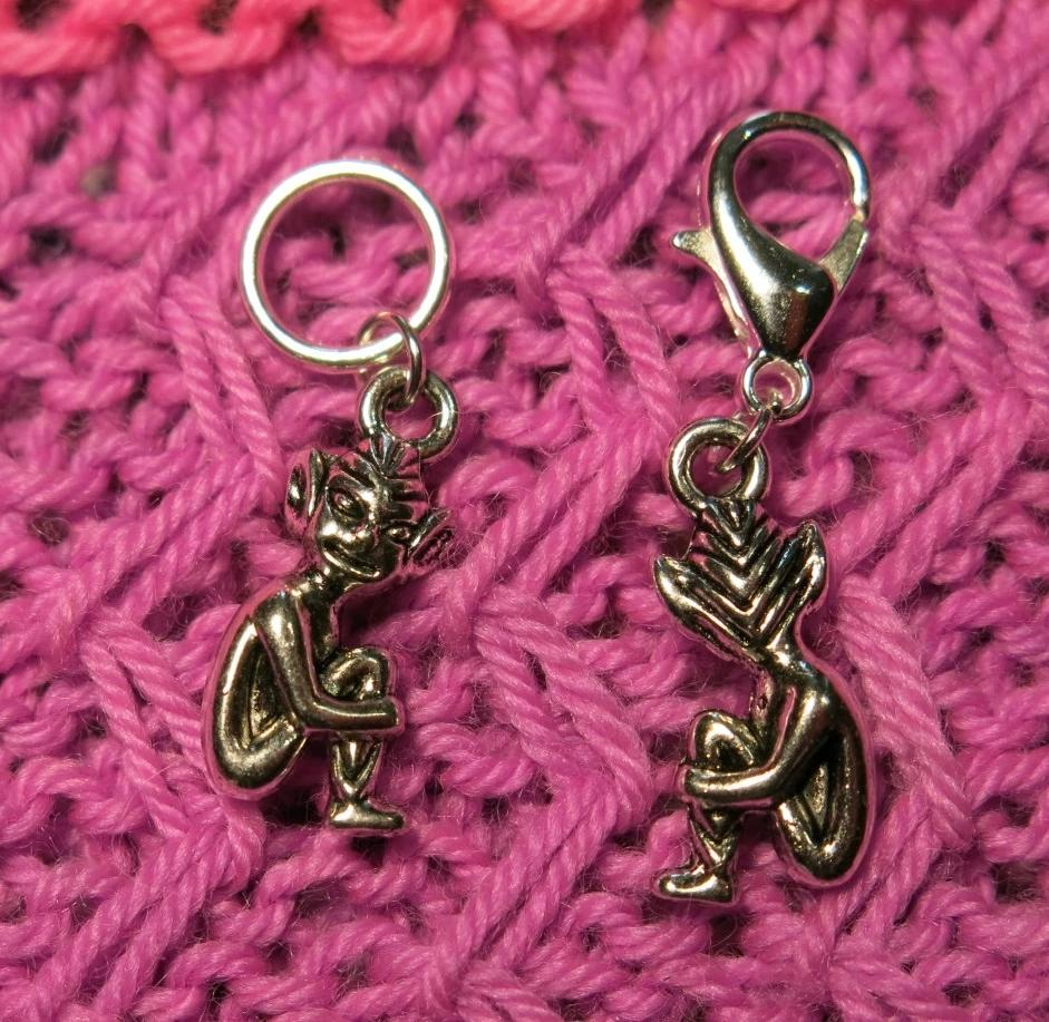 silver alloy stitch marker with a sitting fairy elf