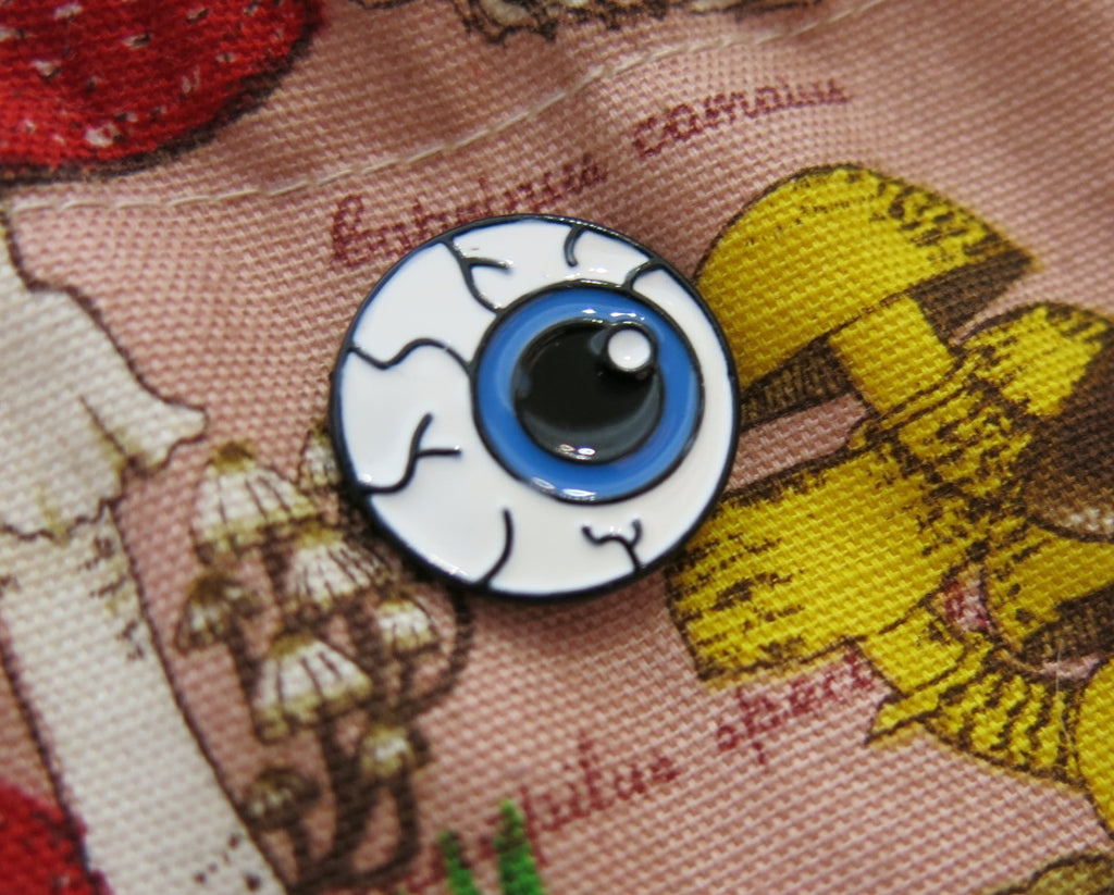 spooky floating bue eyeball lapel pin for bags and shirts