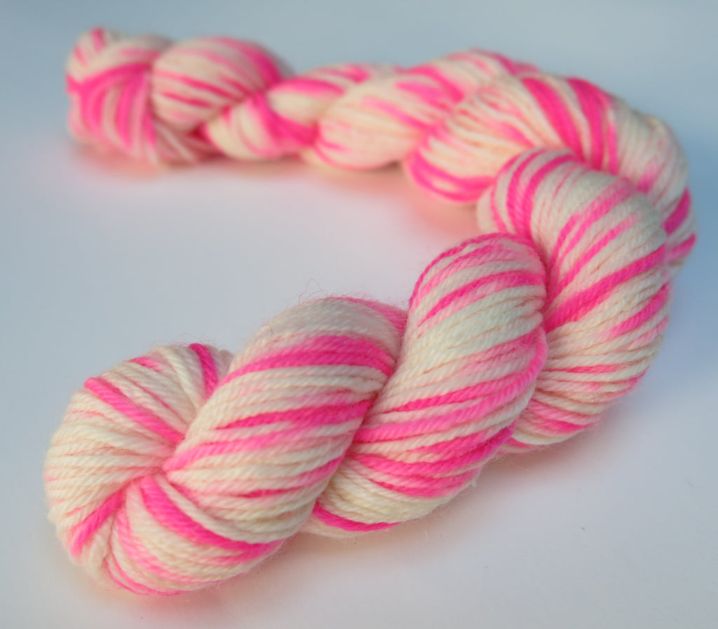bright neon pink and white sock yarn mini skein for knitting and crochet