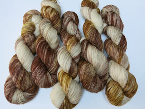 hand dyed superwash merino and nylon sock yarn in browns and creams