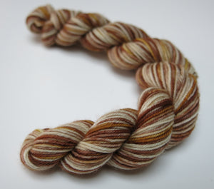 20g sock yarn mini skein is browns and creams by my mama knits