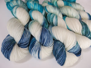 sea blues and white sock yarn for knitting and crochet