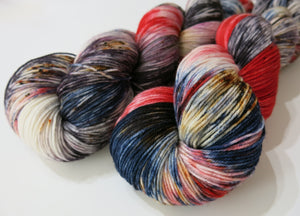 red blue and dark speckled merino sock yarn inspired by the redcap