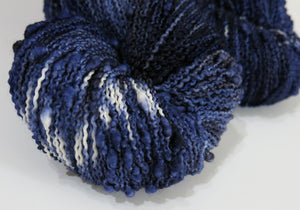 indie dyed night sky coloured slub yarn in dark blues with pops of white stars