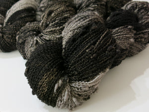 black bull by my mama knits a grey and black slub 4 ply yarn