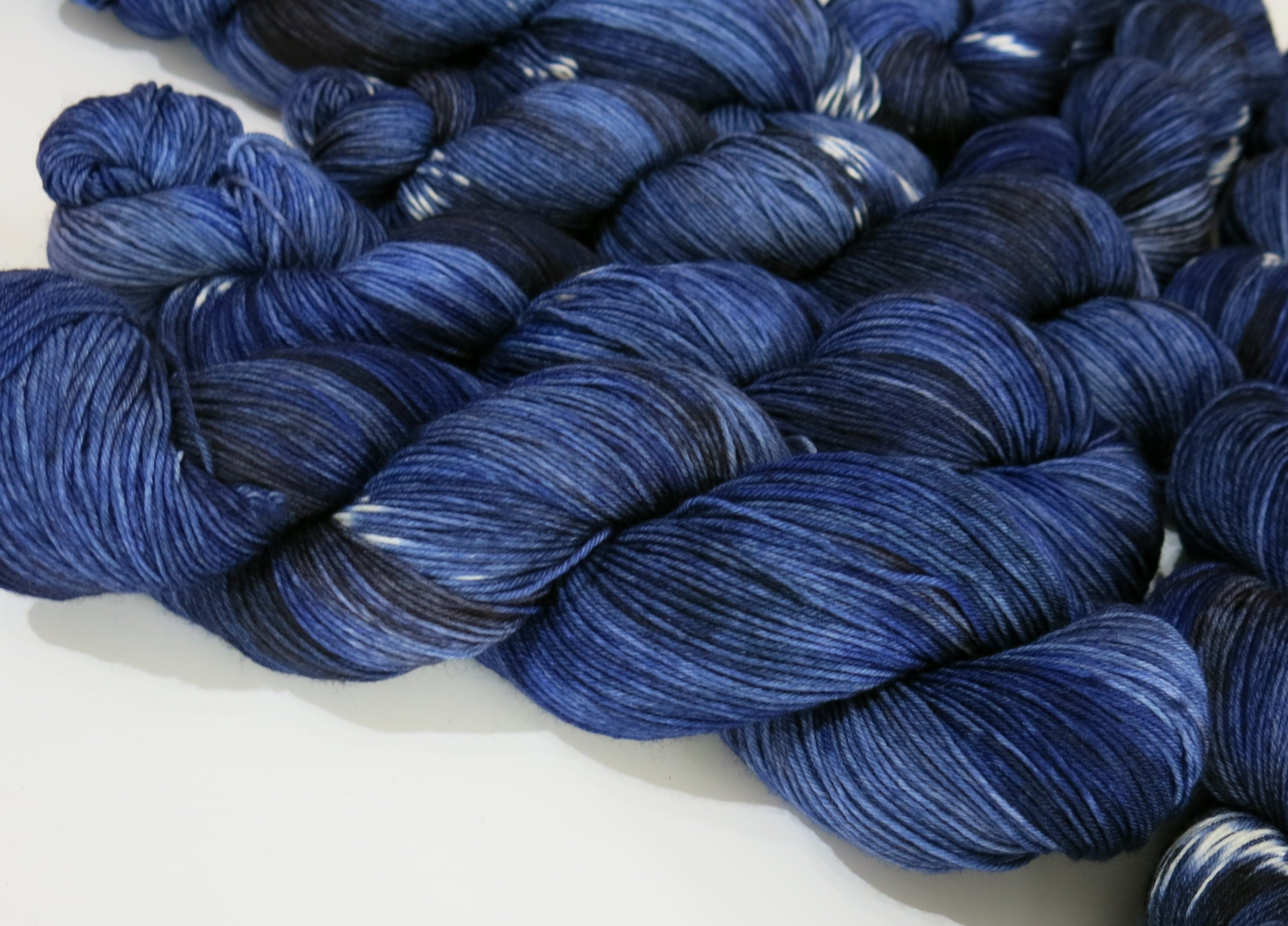 space star constellation inspired blue and white sock yarn skeins