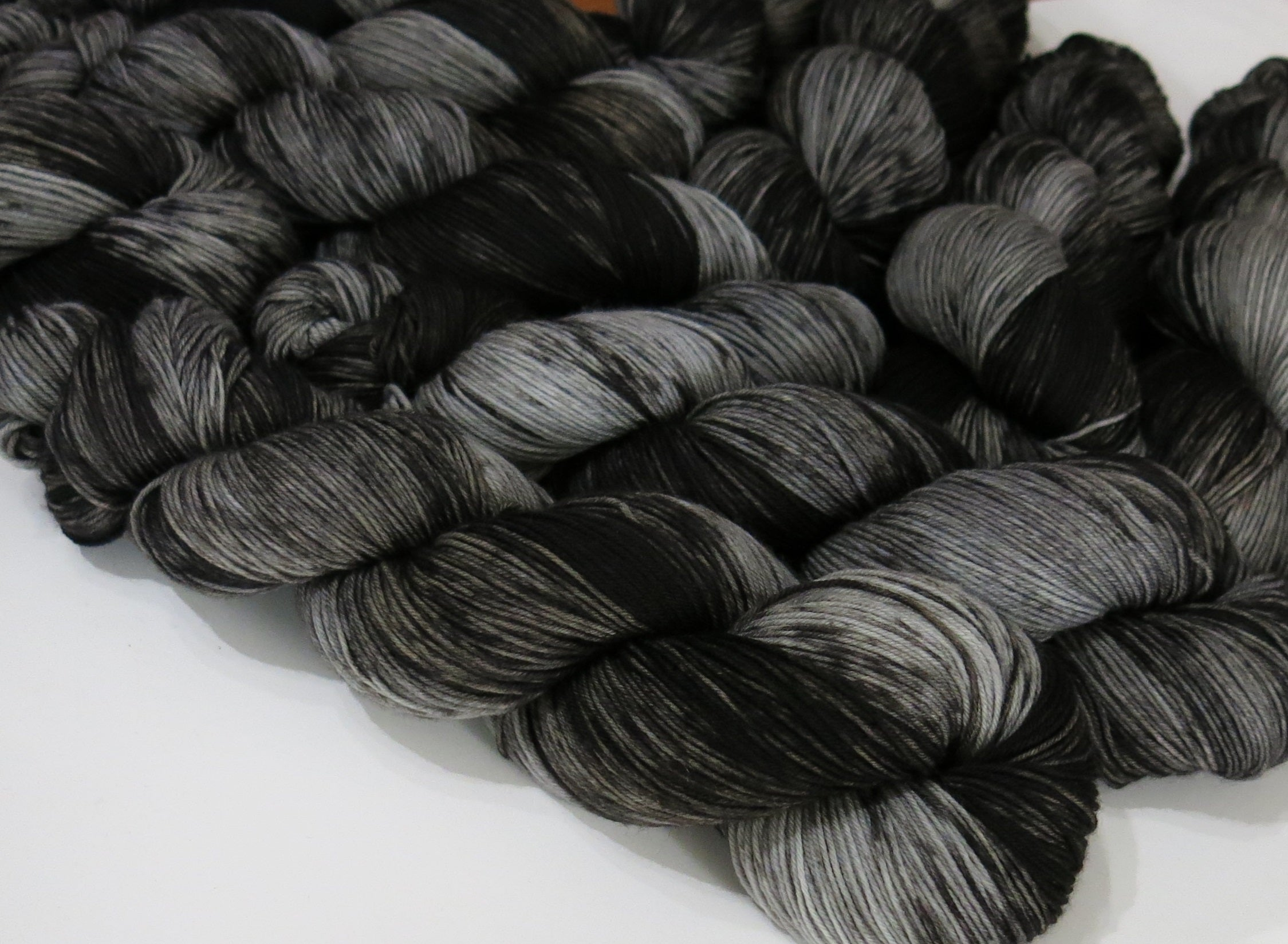 tonal black and grey sock yarn skeins inspired by fairytale bulls