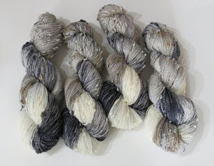 hand dyed textured slub yarn skeins in greys and white
