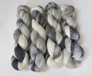 light to dark greys and tans on silk lace weight yarn inspired by a grey horse